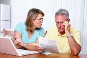 Senior Couple Looking at Bills Considering Declaring Bankruptcy