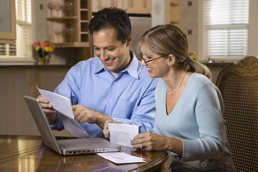 a happy couple viewing their Ontario consumer proposal approval